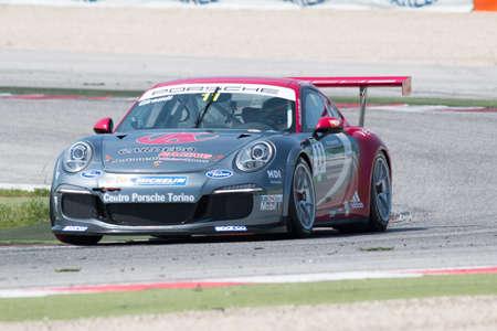 adriatico: MISANO ADRIATICO, Rimini, ITALY - May 10:  A Porsche 911 GT3 Cup of Antonelli Motorsport team, driven By GIRAUDI Gian Luca (ITA), the ,Porsche Carrera Cup car racing on May 10, 2014 in Misano Adriatico, Rimini, Italy. Editorial