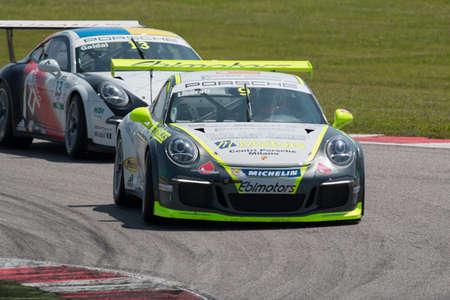 carrera: MISANO ADRIATICO, Rimini, ITALY - May 10:  A Porsche 911 GT3 Cup of Ebimotors team, driven By LIBERATI Edoardo (ITA) , the ,Porsche Carrera Cup car racing on May 10, 2014 in Misano Adriatico, Rimini, Italy.