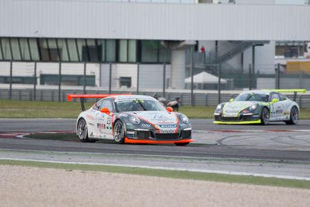 adriatico: MISANO ADRIATICO, Rimini, ITALY - May 10:  A Porsche 911 GT3 Cup of Ebimotors team, driven By POSTIGLIONE Vito (ITA), the ,Porsche Carrera Cup car racing on May 10, 2014 in Misano Adriatico, Rimini, Italy.