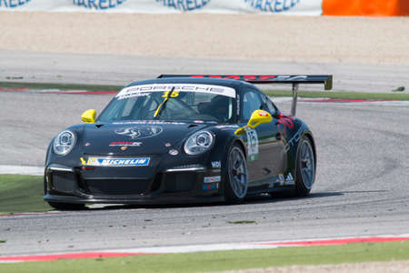 rus: MISANO ADRIATICO, Rimini, ITALY - May 10:  A Porsche 911 GT3 Cup of Sportec Motorsport team, driven By MELNIKOV Ilya (RUS) , the ,Porsche Carrera Cup car racing on May 10, 2014 in Misano Adriatico, Rimini, Italy.