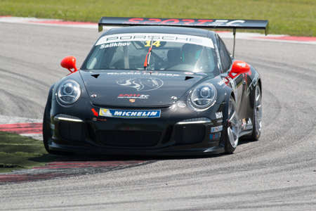 rus: MISANO ADRIATICO, Rimini, ITALY - May 10:  A Porsche 911 GT3 Cup of Sportec Motorsport team, driven By SALIKHOV Rinat (RUS), the  Porsche Carrera Cup car racing on May 10, 2014 in Misano Adriatico, Rimini, Italy. Editorial