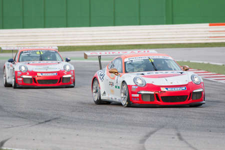 carrera: MISANO ADRIATICO, Rimini, ITALY - May 10:  A Porsche 911 GT3 Cup of Ghinzani Arco Motorsport team, driven By DE AMICIS Alberto (ITA), the ,Porsche Carrera Cup car racing on May 10, 2014 in Misano Adriatico, Rimini, Italy.