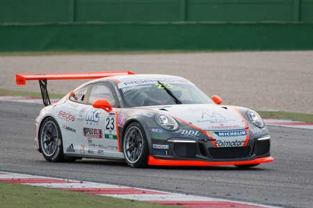 carrera: MISANO ADRIATICO, Rimini, ITALY - May 10:  A Porsche 911 GT3 Cup of Ebimotors team, driven By POSTIGLIONE Vito (ITA), the ,Porsche Carrera Cup car racing on May 10, 2014 in Misano Adriatico, Rimini, Italy.
