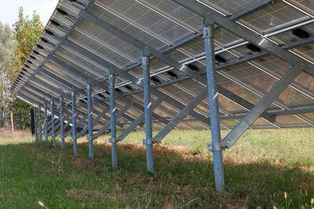modern solar panels in a beautiful green field Stok Fotoğraf