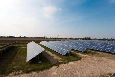 modern solar panels in a beautiful green field photo