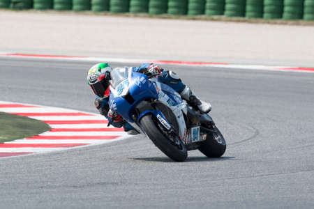 adriatico: MISANO ADRIATICO, ITALY - JUNE 21: Honda CBR600RR of Team Lorini, driven by BUSSOLOTTI Marco in action during the Supersport Free Practice 3th Session during the FIM SUPERSPORT World Championship - Race at Misano World Circuit on June 21, 2014 in Misano A