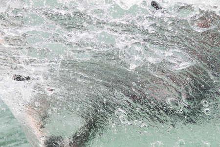 kitesurf: LAKE OF SANTA CROCE, ITALY - JULY 12: Professional kite-surfer demonstrating his ability 2014, July 12, 2014 in Lake of Santa Croce, Alpago, belluno, Italy Editorial