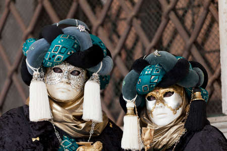 st  marks square: Venice, Italy – February 11, 2012: People posing wearing a typical Carnival mask in St. Marks Square
