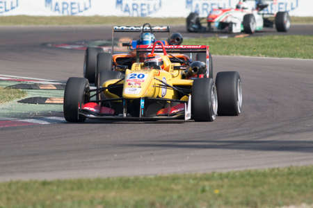 carlin: Imola, Italy - October 11, 2014: Dallara F312 Volkswagen of Jagonya Ayam with Carlin Team, driven by Sean Gelael (Idn) in action During The FIA ??Formula 3 European Championship
