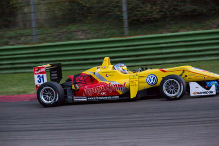 enzo: Imola, Italy - October 11, 2014: Dallara F312 NBE R of T-Sport team, driven by Nick Cassidy (Nzl) in action During The FIA ??Formula 3 European Championship - Race in Imola at Enzo & Dino Ferrari Circuit