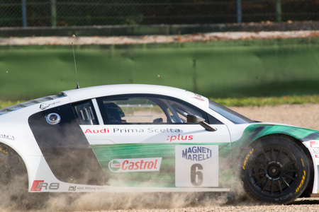 imola: Imola, Italy - October 11, 2014: A Audi R8 Lms of Audi Sport Italia team, driven By Mapelli Marco (Ita) and Schoffler Thomas (Deu),  the C.I. Gran Turismo car racing on October 11, 2014 in Imola, Italy. Editorial