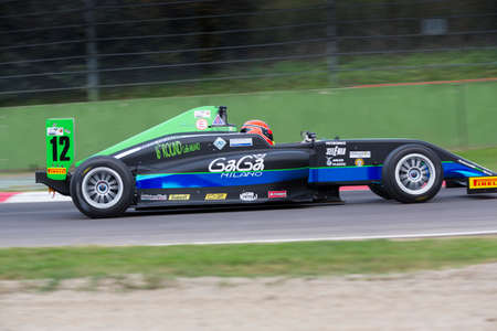 imola: Imola, Italy - October 11, 2014: A Tatuus F.4 T014 Abarth of Antonelli Motorsport  team, driven By Russo Andrea (Ita),  the Italian F4 Championship car racing on October 11, 2014 in Imola, Italy.