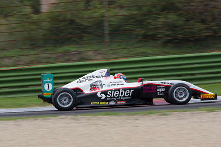alan: Imola, Italy - October 11, 2014: A Tatuus F.4 T014 Abarth of  Jenzer Motorsport team, driven By Valente Alan (Che),  the Italian F4 Championship car racing on October 11, 2014 in Imola, Italy.