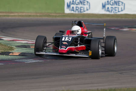 imola: Imola, Italy - October 11, 2014: A Tatuus F.4 T014 Abarth of F & M S.R.L Racing team, driven By Raghunathan Mahaveer (Ind),  the Italian F4 Championship car racing on October 11, 2014 in Imola, Italy.