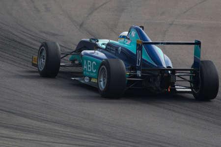 cram: Imola, Italy - October 11, 2014: A Tatuus F.4 T014 Abarth of Cram Motorsport team, driven By Haxhiu Edi (Che),  the Italian F4 Championship car racing on October 11, 2014 in Imola, Italy. Editorial