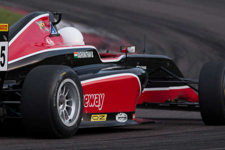 f 15: Imola, Italy - October 11, 2014: A Tatuus F.4 T014 Abarth of F & M S.R.L Racing team, driven By Raghunathan Mahaveer (Ind),  the Italian F4 Championship car racing on October 11, 2014 in Imola, Italy.