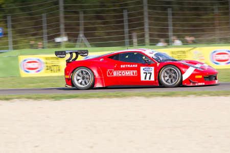 scuderia: Imola, Italy - October 11, 2014: A Ferrari 458 Italia Gt3 of Bms Scuderia Italia team, driven By Pier Guidi Alessandro and Lucchini Luigi, the C.I. Gran Turismo car racing on October 11, 2014 in Imola, Italy. Editorial