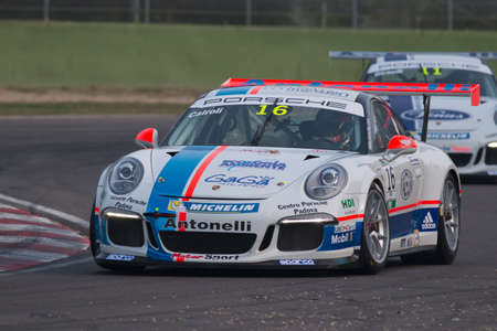imola: Imola, Italy - October 11, 2014: A Porsche 911 Gt3 Cup of Antonelli Motorsport team, driven By Cairoli Matteo (Ita),  the Porsche Carrera Cup Italia car racing on October 11, 2014 in Imola, Italy.