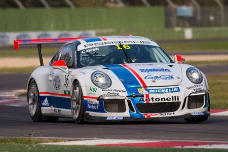 imola: Imola, Italy - October 11, 2014: A Porsche 911 Gt3 Cup of Antonelli Motorsport team, driven By Cairoli Matteo (Ita),  the Porsche Carrera Cup Italia car racing on October 11, 2014 in Imola, Italy.