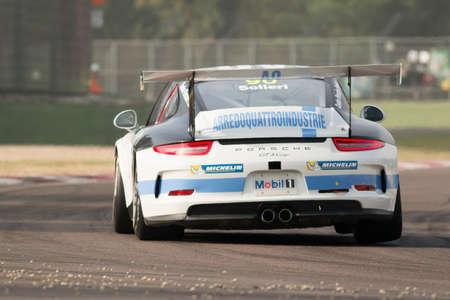 imola: Imola, Italy - October 11, 2014: A Porsche 911 Gt3 Cup of Antonelli Motorsport team, driven By Solieri Glauco (Ita),  the Porsche Carrera Cup Italia car racing on October 11, 2014 in Imola, Italy. Editorial