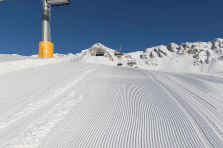 Skiing background - fresh snow on ski slope in the dolomites photo
