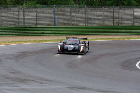 enzo: Imola, Italy – May 16, 2015: Ginetta – Nissan of SVK By Speed Factory Team, driven by Konstantin Calko - Jesus Fuster and Dainius Matijosaitis in action during the European Le Mans Series - 4 Hours of Imola in Autodromo Enzo & Dino Ferrari on May 16,  Editorial