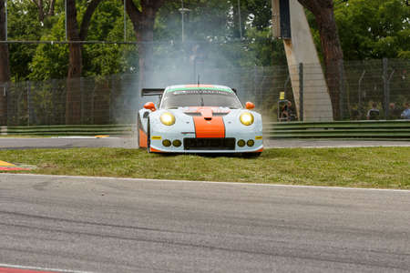 keen: Imola, Italy – May 16, 2015: Porsche 911 RSR of GULF RACING UK Team, driven by Michael Wainwright  - Adam Carroll  - Philip Keen in action during the European Le Mans Series - 4 Hours of Imola in Autodromo Enzo & Dino Ferrari on May 16, 2015 in Imola, I