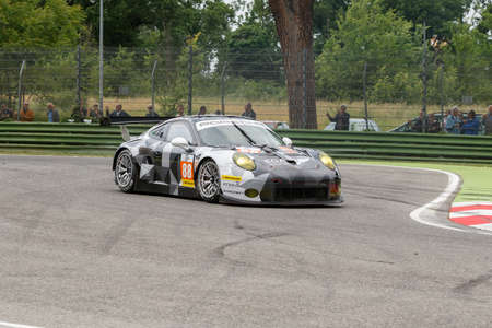 proton: Imola, Italy – May 16, 2015: Porsche 911 RSR of PROTON COMPETITION Team, driven by Richard Lietz - Marco Mapelli - Christian Ried in action during the European Le Mans Series - 4 Hours of Imola in Autodromo Enzo & Dino Ferrari on May 16, 2015 in Imola,