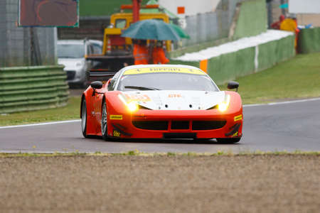 imola: Imola, Italy - May 16, 2015: Ferrari F458 of Italian AF Corse team, driven by Duncan Cameron - Matt Griffin and Aaron Scott in action During The European Le Mans Series - 4 Hours of Imola Autodromo Dino Ferrari Enzo on May 16, 2015 in Imola, Italy. Editorial