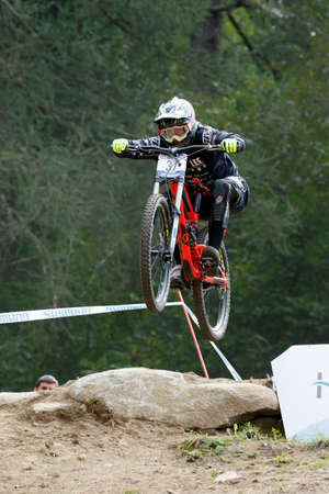 scott: Val Di Sole, Italy - 22 August 2015: Lac Blanc Scott Team rider Pierron Amaury, in action during the mens elite Downhill final World Cup at the Uci Mountain Bike in Val di Sole, Trento, Italy
