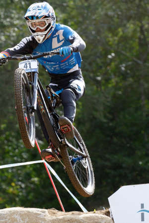 wilson: Val Di Sole, Italy - 22 August 2015: Unior Tools Team Rider Wilson Reece, in action during the mens elite Downhill final World Cup at the Uci Mountain Bike in Val di Sole, Trento, Italy