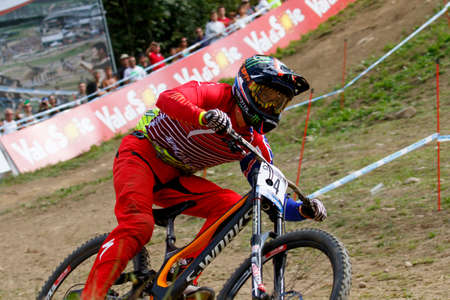 specialized: Val Di Sole, Italy - 22 August 2015: Specialized Racing Team rider Brosnan Troy, in action during the mens elite Downhill final World Cup at the Uci Mountain Bike in Val di Sole, Trento, Italy