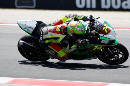 ssd: Misano Adriatico, Italy - June 20, 2015: Kawasaki ZX-6R of Renzi Corse Srl SSD Team, driven by SABATINO Gennaro in action during the Superstock 600 Qualifying  during the FIM Superstock 600 - race at Misano World Circuit on June 20, 2015 in Misano Adriati