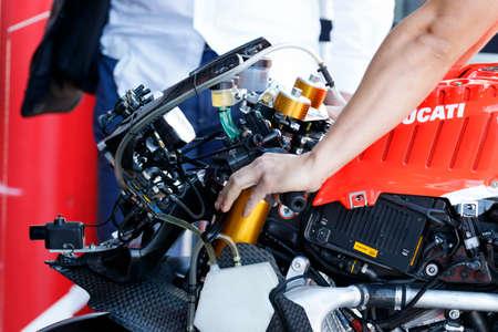 adriatico: MISANO ADRIATICO, ITALY - JUNE 21, 2015:  mechanic working during the FIM Superbike World Championship - Race at Misano World Circuit on June 21, 2015 in Misano Adriatico, Italy.