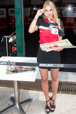 adriatico: MISANO ADRIATICO, ITALY - JUNE 20, 2015: A grid girls pose for fans during the pit walk during qualifying for round one of the Superbike World Championship at Misano World Circuit on June 20, 2015,  in Misano Adriatico, Italy. Editorial