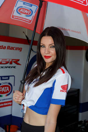 adriatico: MISANO ADRIATICO, ITALY - JUNE 21, 2015: A grid girls pose for fans during the pit walk during qualifying for round one of the Superbike World Championship at Misano World Circuit on June 21, 2015,  in Misano Adriatico, Italy.