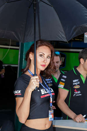 superbike: MISANO ADRIATICO, ITALY - JUNE 21, 2015: A grid girls pose for fans during the pit walk during qualifying for round one of the Superbike World Championship at Misano World Circuit on June 21, 2015,  in Misano Adriatico, Italy.