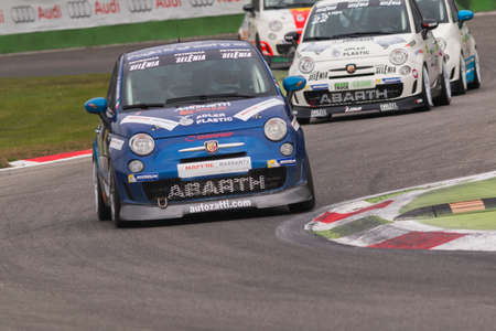 imola: Monza, Italy - October 25, 2014: Fiat Abarth 695 of  C&C Racing  Team, driven by Campani Alex in action during the Abarth Italia & Europa Trophy - Race in Autodromo Nazionale di Monza Circuit on October 25, 2014 in Imola, Italy Editorial
