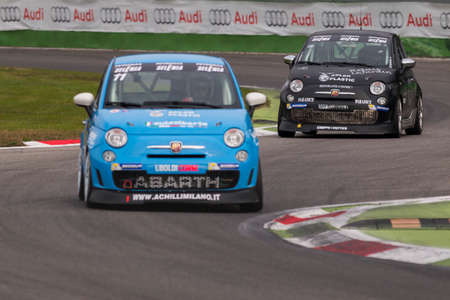 imola: Monza, Italy - October 25, 2014: Fiat Abarth 695 of Uboldi Corse Team, driven by GAGLIANO Massimiliano in action during the Abarth Italia & Europa Trophy - Race in Autodromo Nazionale di Monza Circuit on October 25, 2014 in Imola, Italy.