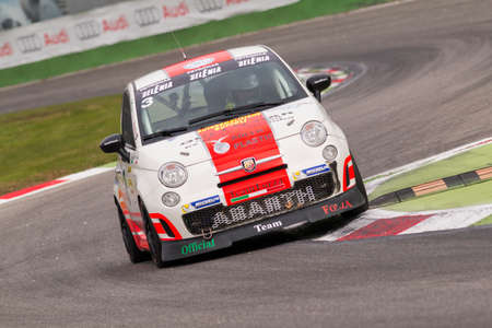 mario: Monza, Italy - October 25, 2014: Fiat Abarth 695 of  Forza Servic Team, driven by Buffoli Manuel Mario in action during the Abarth Italia & Europa Trophy - Race in Autodromo Nazionale di Monza Circuit on October 25, 2014 in Imola, Italy.