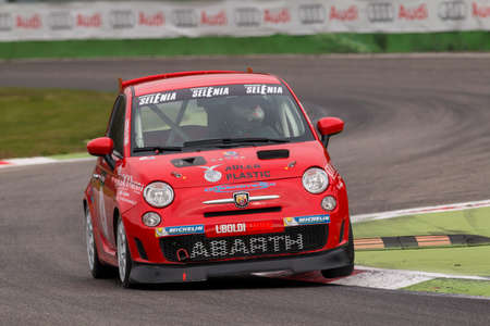 cosmo: Monza, Italy - October 25, 2014: Fiat Abarth 500 of Uboldi Corse Team, driven by DI COSMO Alfredo in action during the Abarth Italia & Europa Trophy - Race in Autodromo Nazionale di Monza Circuit on October 25, 2014 in Imola, Italy. (Photo by Mauro Dalla
