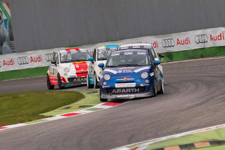 cc: Monza, Italy - October 25, 2014: Fiat Abarth 695 of  C&C Racing  Team, driven by Campani Alex in action during the Abarth Italia & Europa Trophy - Race in Autodromo Nazionale di Monza Circuit on October 25, 2014 in Imola, Italy Editorial