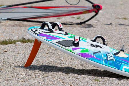 kitesurf: LAKE OF SANTA CROCE, ITALY - JULY 13, 2014: A kitesurfboard in the beach LAKE OF SANTA CROCE