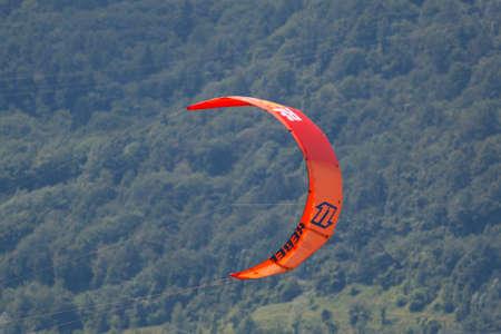 kitesurf: LAKE OF SANTA CROCE, ITALY - JULY 13:  Close-up of kitesurfing sail on Lake of Santa Croce, Alpago, belluno, Italy