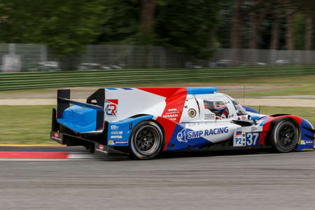 anton: Imola, Italy May 16, 2015: Nissan BR01 of SMP Racing Team, driven by Mikhail Aleshin - Kirill Ladygin - Anton Ladygin in action During The European Le Mans Series - 4 Hours of Imola Autodromo Dino Ferrari Enzo on May 16, 2015 in Imola , Italy.