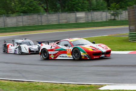 mann: Imola, Italy May 16, 2015: Ferrari F458 of Italian AF Corse team, driven by Peter Mann - Raffaele Giammaria and Matteo Cressoni in action During The European Le Mans Series - 4 Hours of Imola Autodromo Dino Ferrari Enzo on May 16, 2015 Imola, Italy.