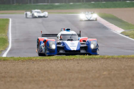 mikhail: Imola, Italy - May 16, 2015: Nissan BR01 of SMP Racing Team, driven by Mikhail Aleshin - Kirill Ladygin - Anton Ladygin in action During The European Le Mans Series - 4 Hours of Imola Autodromo Dino Ferrari Enzo on May 16, 2015 Imola, Italy. Editorial