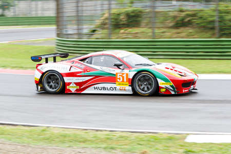 enzo: Imola, Italy - May 16, 2015: Ferrari F458 of Italian AF Corse team, driven by Peter Mann - Raffaele Giammaria and Matteo Cressoni in action During The European Le Mans Series - 4 Hours of Imola Autodromo Dino Ferrari Enzo on May 16, 2015 in Imola, Italy.