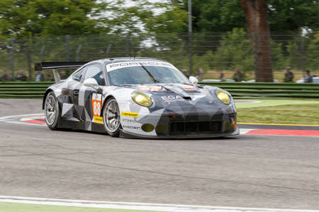 enzo: Imola, Italy May 16, 2015: Porsche 911 RSR of Proton COMPETITION Team, driven by Richard Lietz - Marco Mapelli - Christian Ried in action During The European Le Mans Series - 4 Hours of Imola Autodromo Dino Ferrari Enzo on May 16, 2015 Imola, Italy.