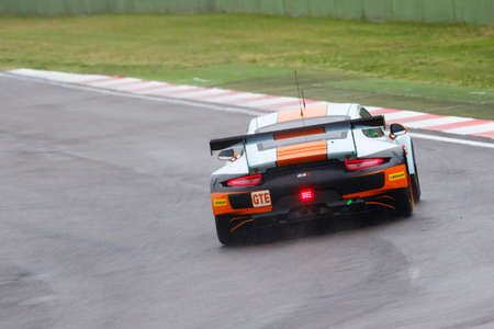 imola: Imola, Italy May 16, 2015: Porsche 911 RSR of GULF RACING UK Team, driven by Michael Wainwright - Adam Carroll - Philip Keen in action During The European Le Mans Series - 4 Hours of Imola Autodromo Dino Ferrari Enzo on May 16, 2015 in Imola, Italy. Editorial